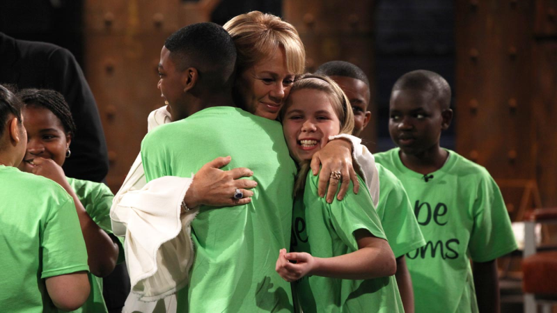 The youth get a hug from Arlene Dickinson on Dragon's Den