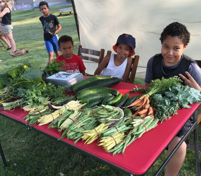 3 youth sell produce grown in their gardens